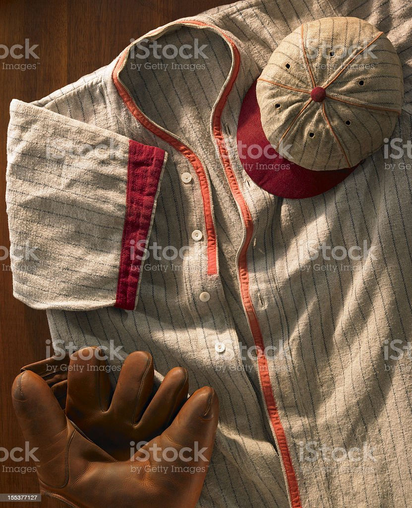 Old-time wool baseball uniform with cap and glove stock photo