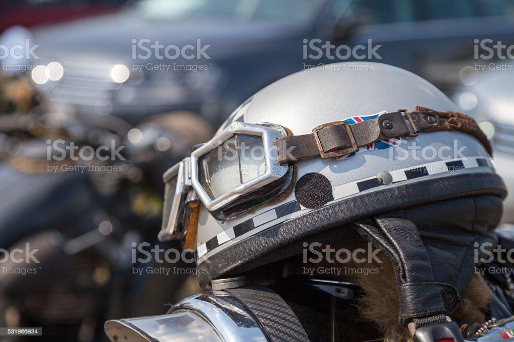 oldtimer motorcycle helmet lies on motorcycle stock photo