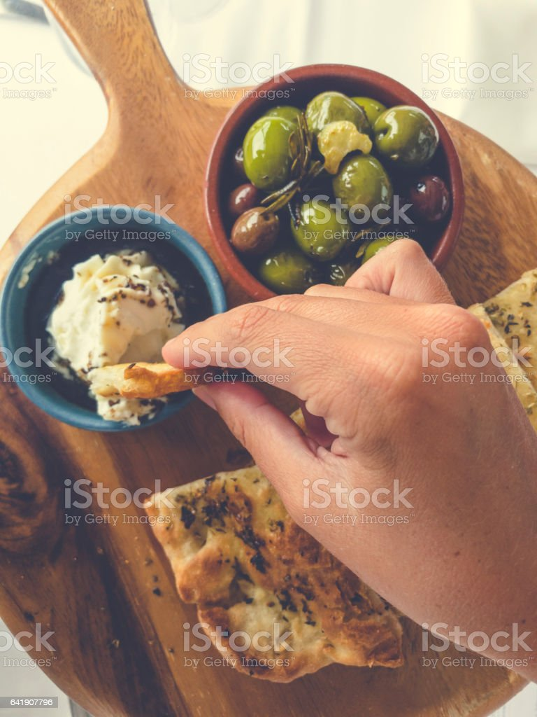 Olive cheese and bread appetizer on a cutting board. stock photo