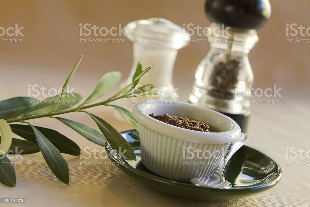 Olive Dip with Leaves royalty-free stock photo