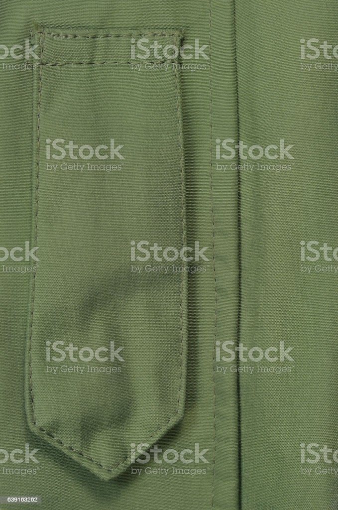 Olive Drab Green ECWCS Parka Rank Insignia Badge Loop Closeup stock photo
