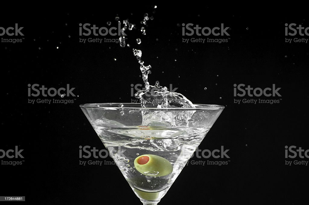 Olive dropped into Martini royalty-free stock photo