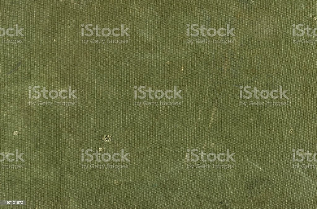 Olive green cotton texture with scratches ans rips stock photo