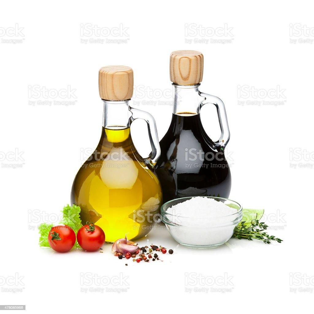 Olive oil and balsamic vinegar bottles on white backdrop stock photo