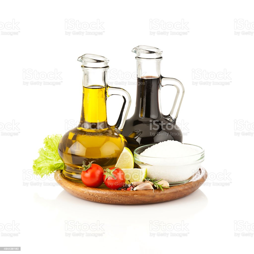 Olive oil and balsamic vinegar bottles on white backdrop stock photo