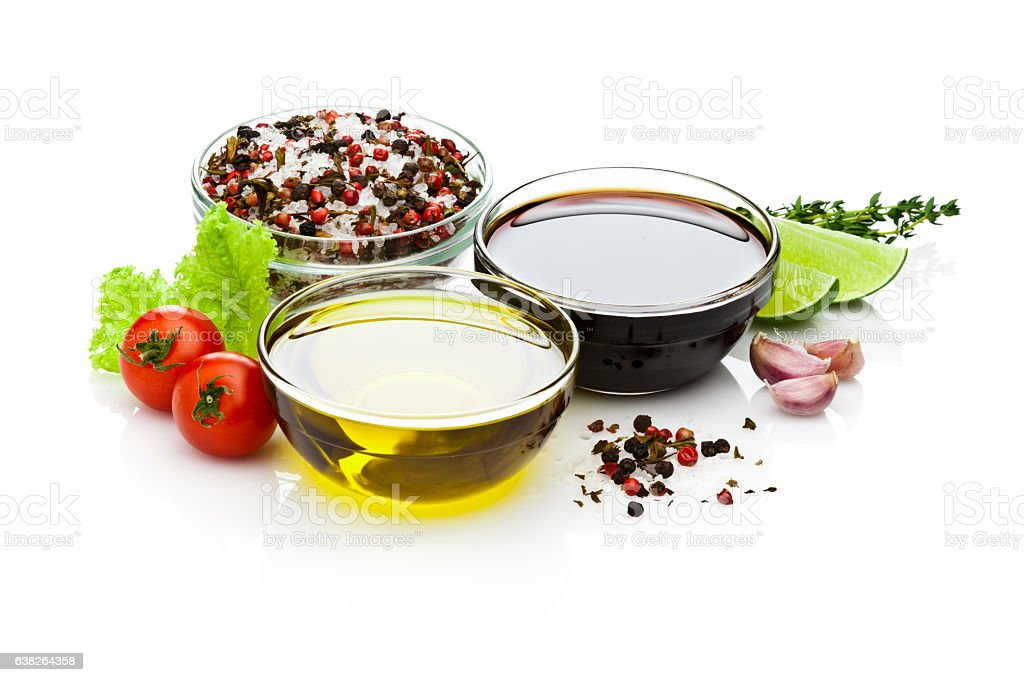 Olive oil and balsamic vinegar bowls on white backdrop stock photo