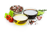 Olive oil and balsamic vinegar bowls on white backdrop