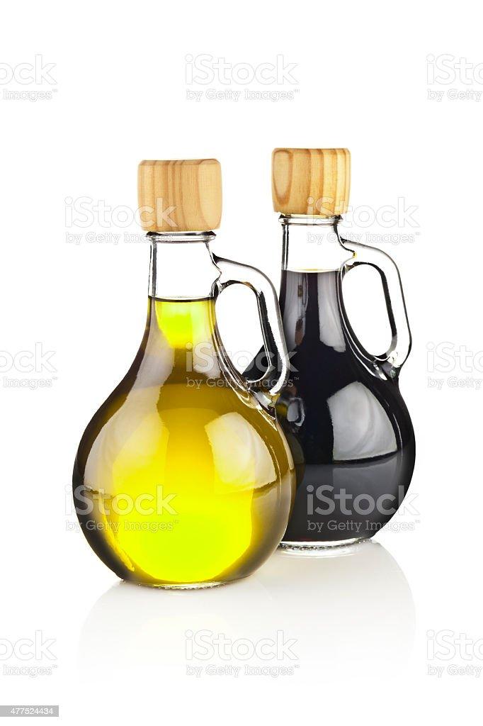 Olive oil and balsamic vinegar in glass bottles stock photo