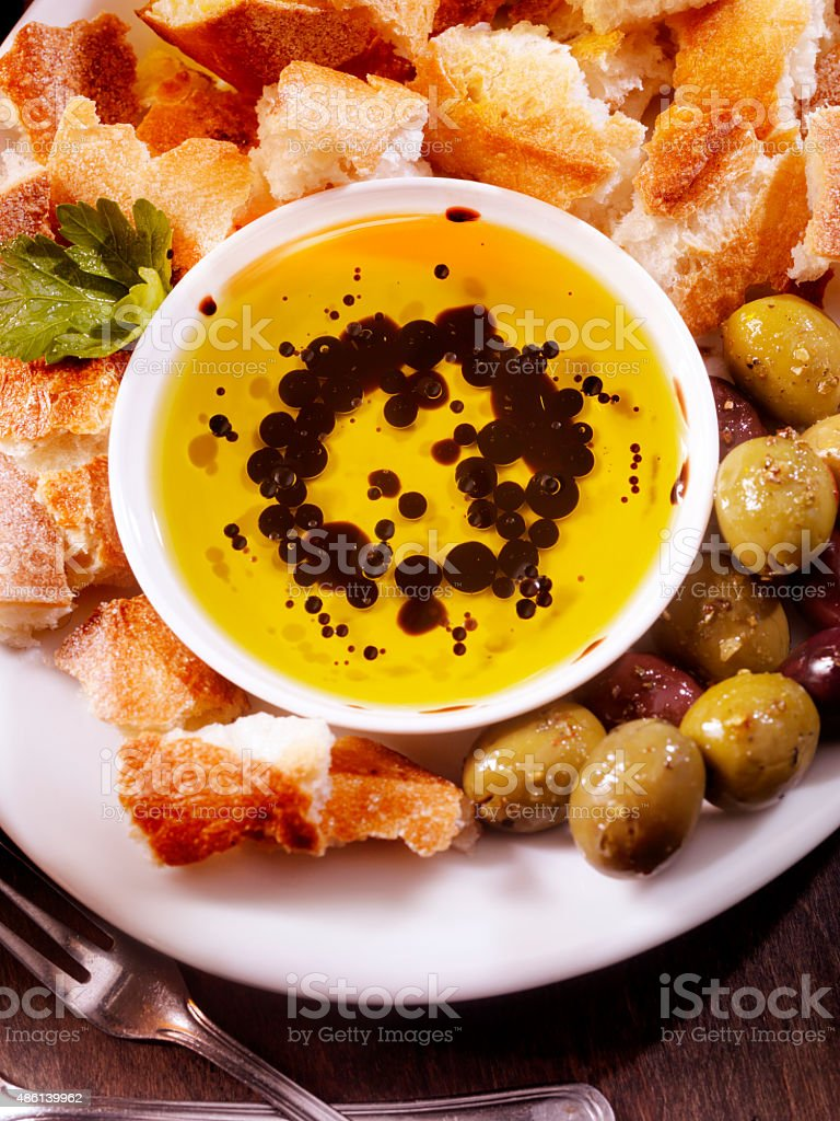 Olive Oil and Balsamic Vinegar with Crusty French Bread stock photo