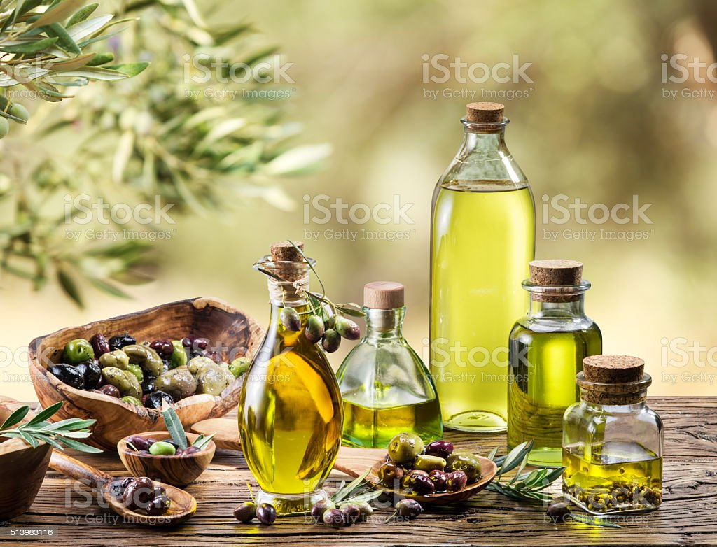 Olive oil and berries. stock photo