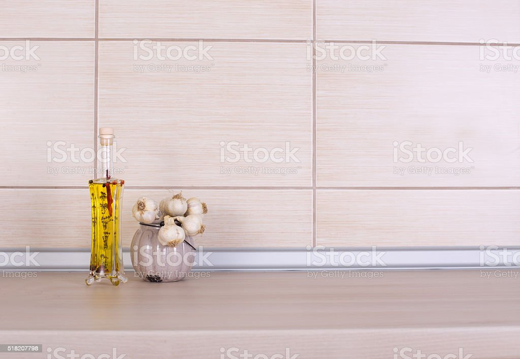 Olive oil and garlic on countertop stock photo