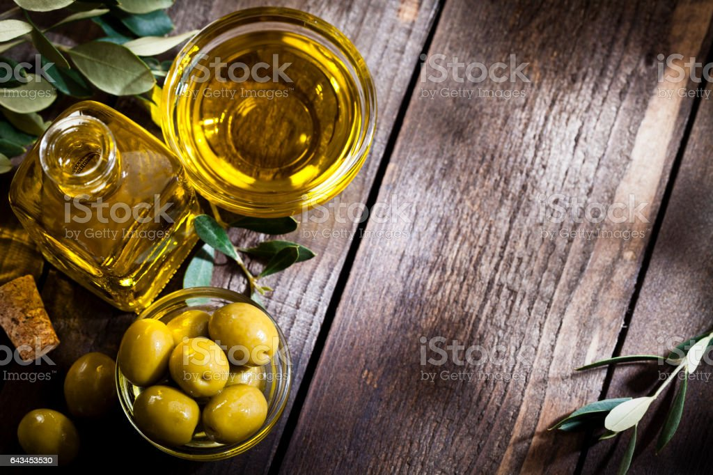 Olive oil and green olives shot from above with copy space stock photo