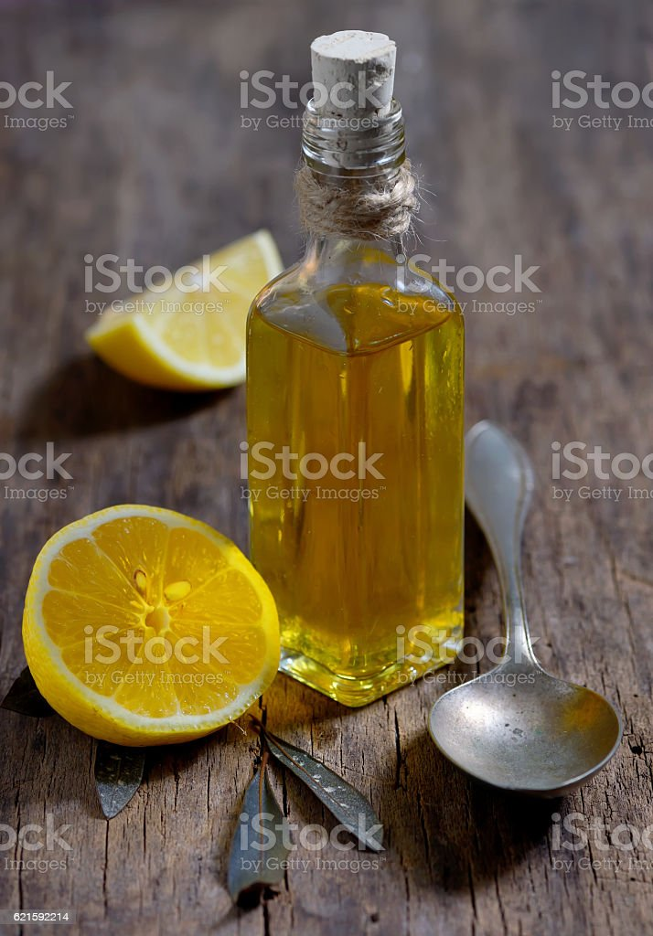 Olive oil and  lemon fruits on the wooden table stock photo
