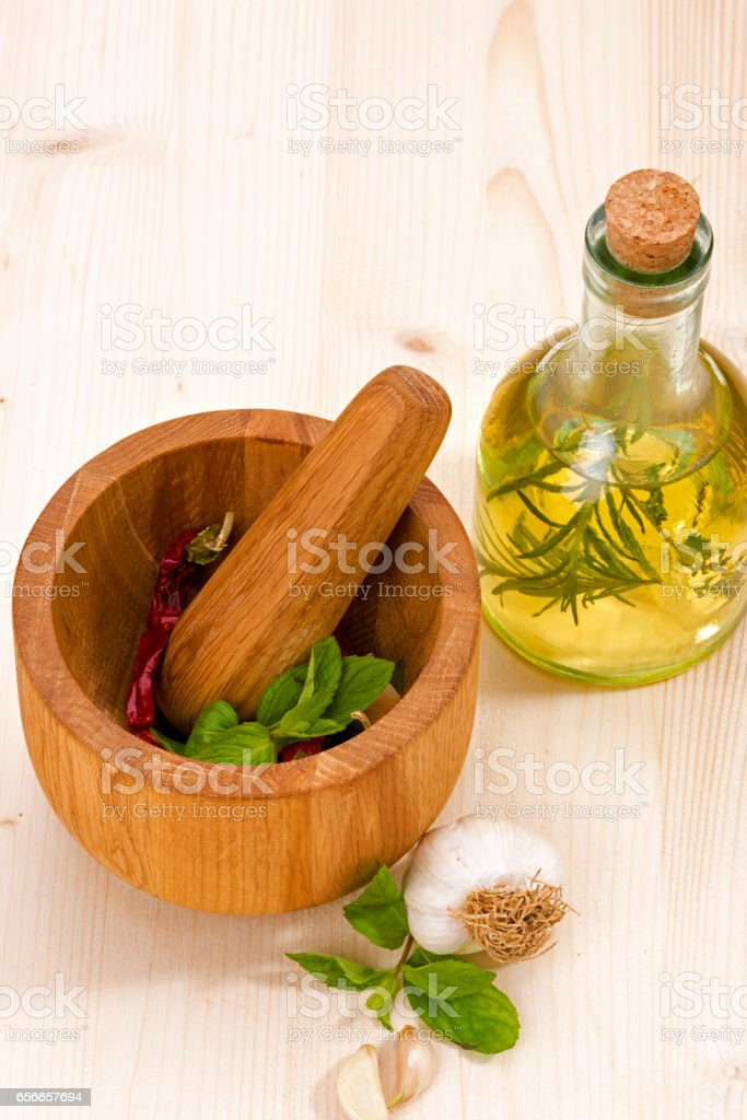 Olive Oil and Mortar with Garlic stock photo