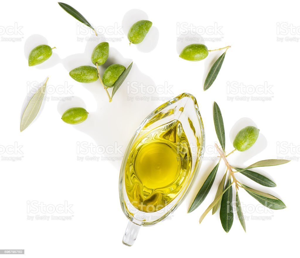 Olive oil and olive branch, above view. stock photo
