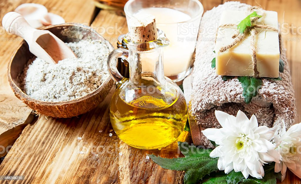 Olive oil based spa items on a wooden table stock photo