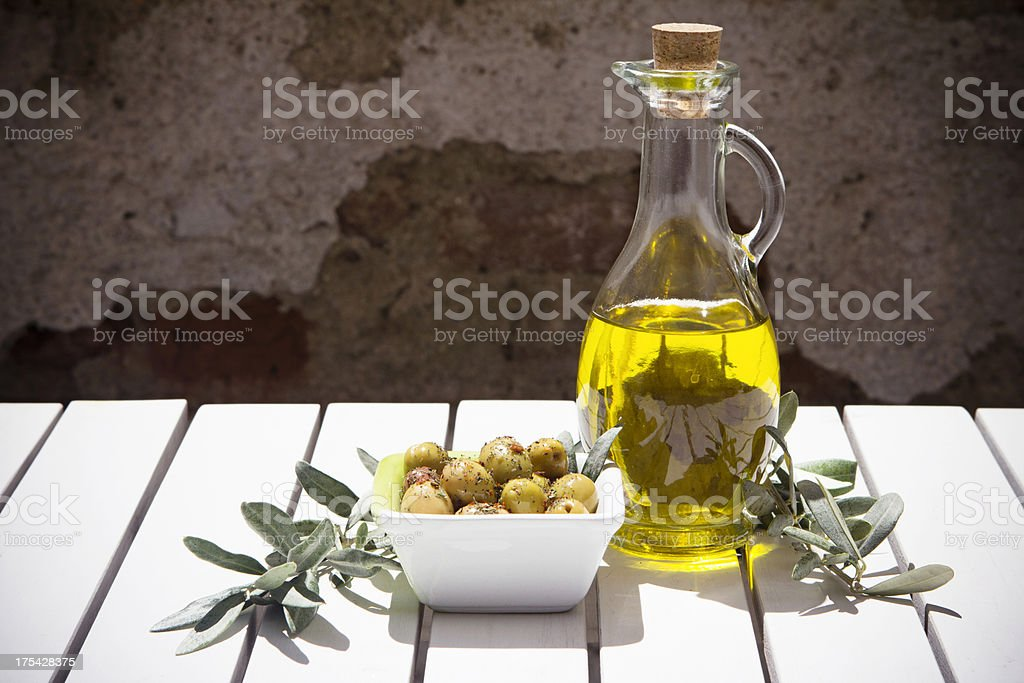 Olive oil bottle and branch stock photo