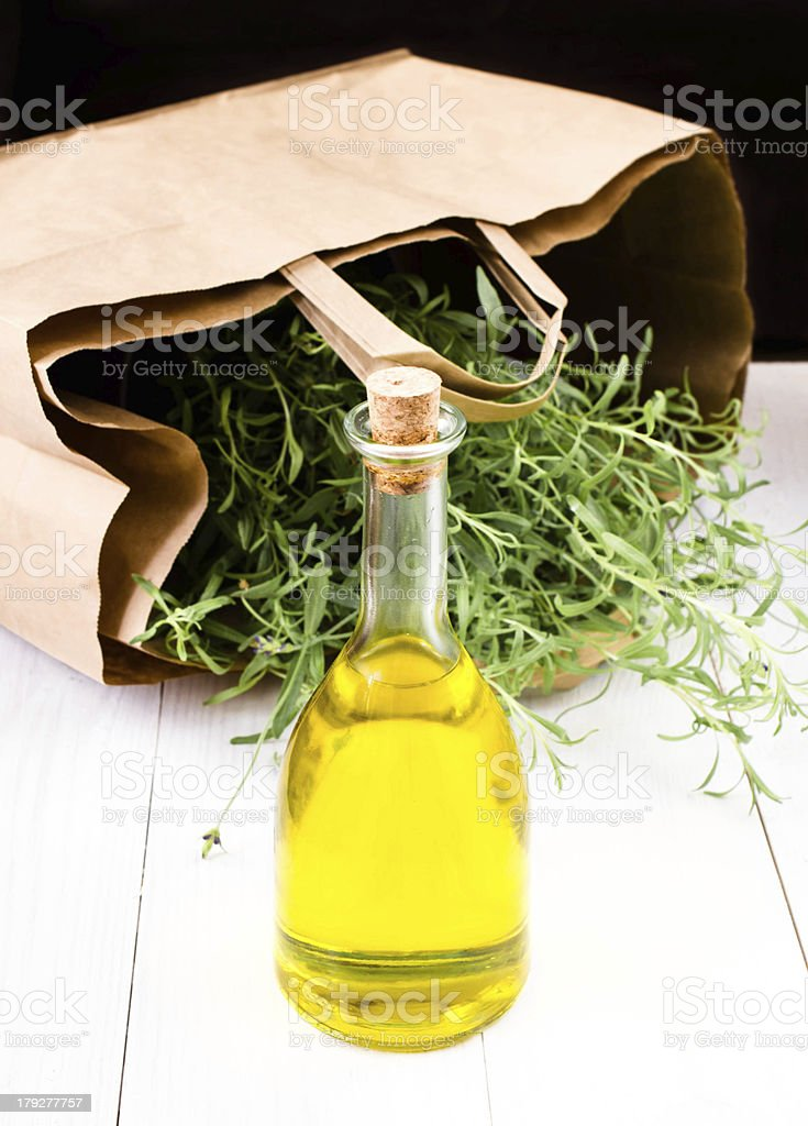 Olive oil bottle and herbs with Paper bag royalty-free stock photo