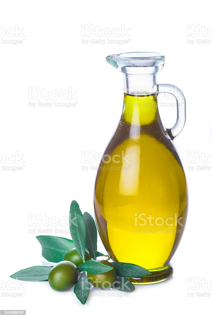 Olive oil bottle with leaves isolated on white background stock photo