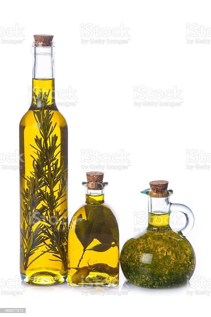 Olive oil bottles with aromatic herbs stock photo