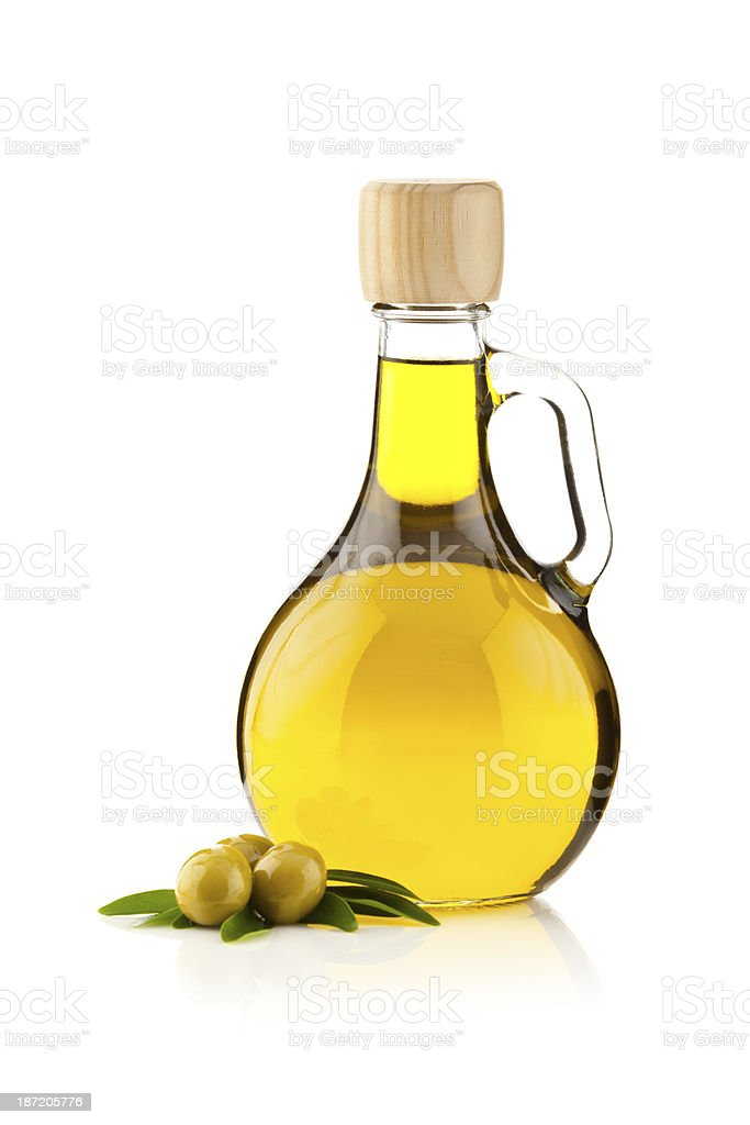 Olive oil contained in an round shaped bottle stock photo