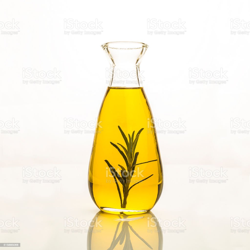 Olive oil flavored with rosemary isolated stock photo