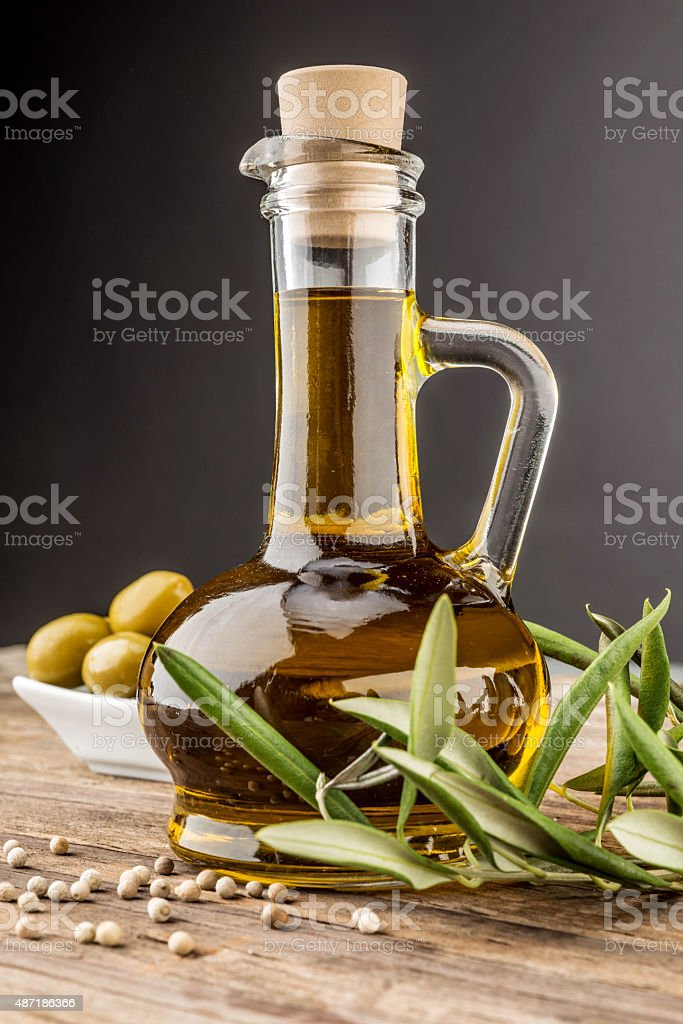 Olive oil, green olives and pepper stock photo