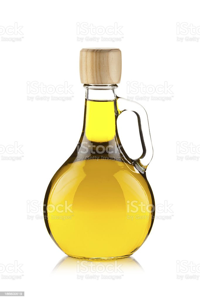 Olive oil in a clean glass bottle with a handle stock photo