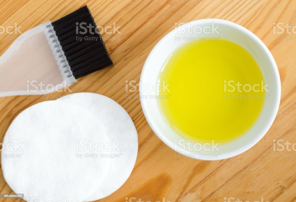 Olive oil in a small ceramic bowl for preparing homemade spa face and hair masks. Ingredients for diy cosmetics. stock photo