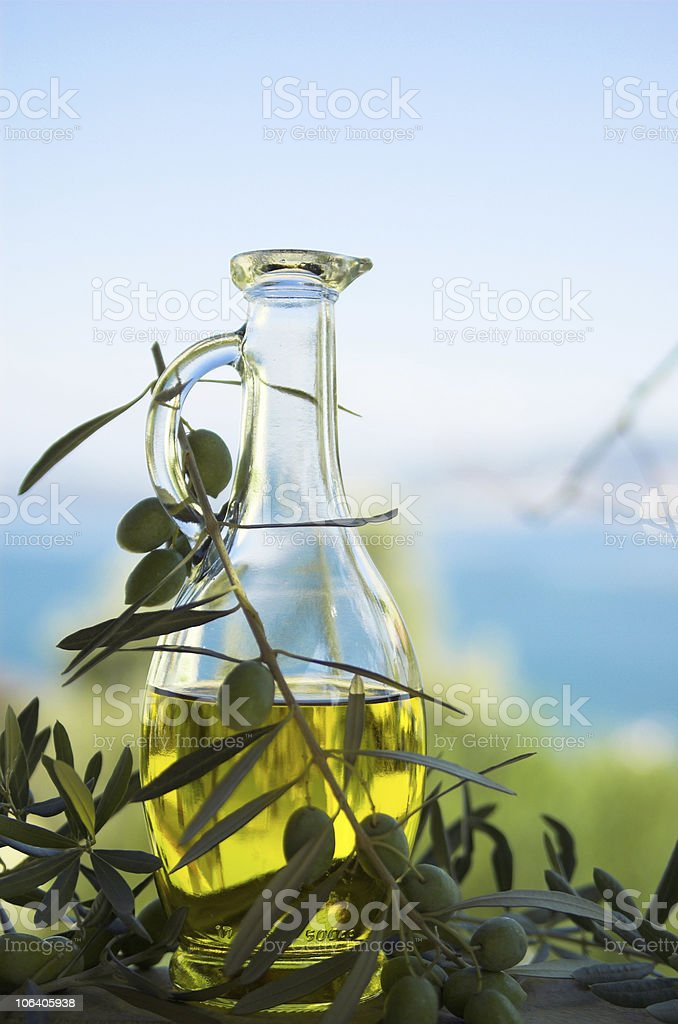 olive oil in bottle, leaves and olives royalty-free stock photo
