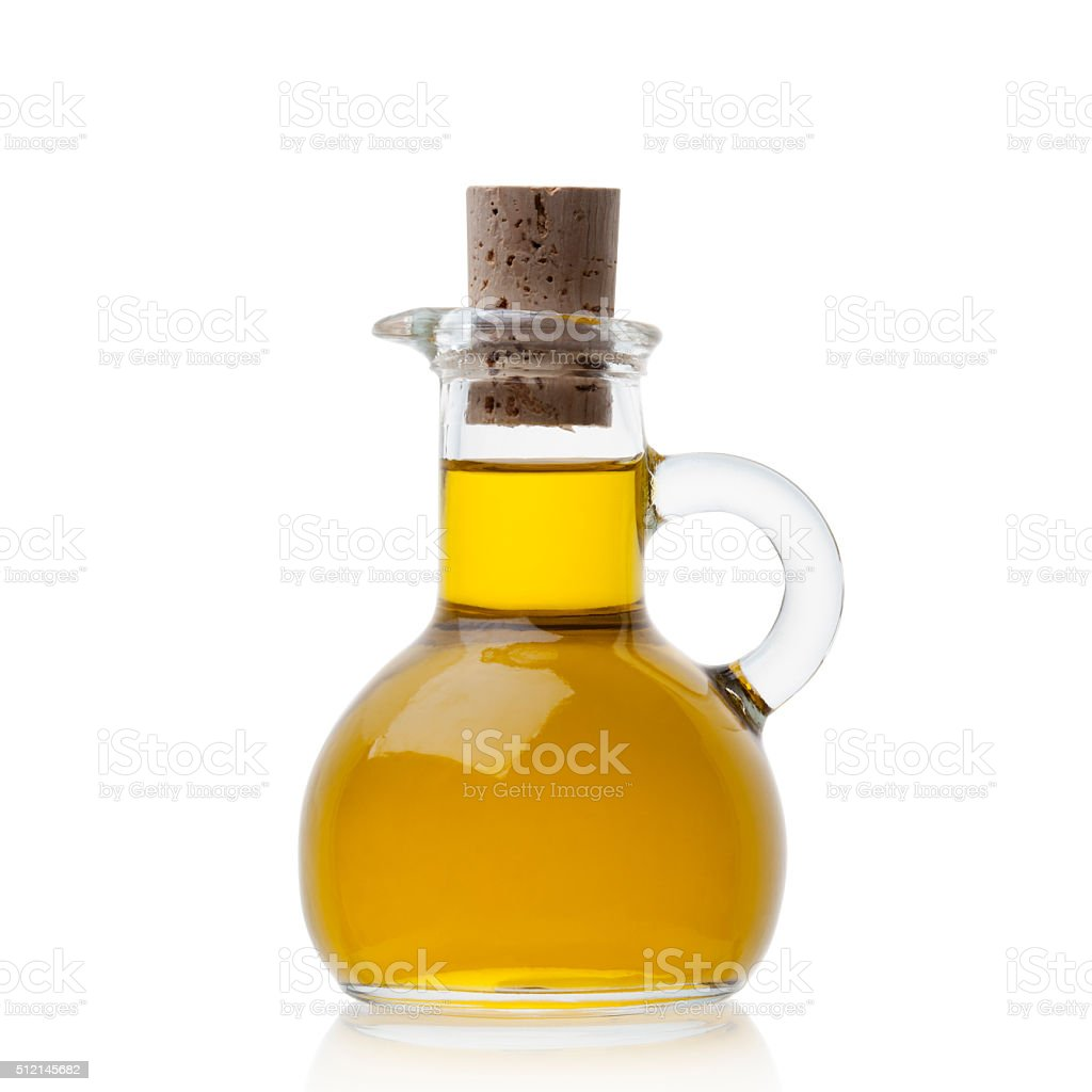 Olive oil in closed glass bottle stock photo