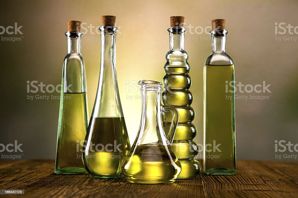 Olive oil in different shaped bottles royalty-free stock photo