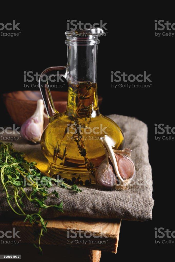 Olive oil in glass bottle on linen napkin stock photo