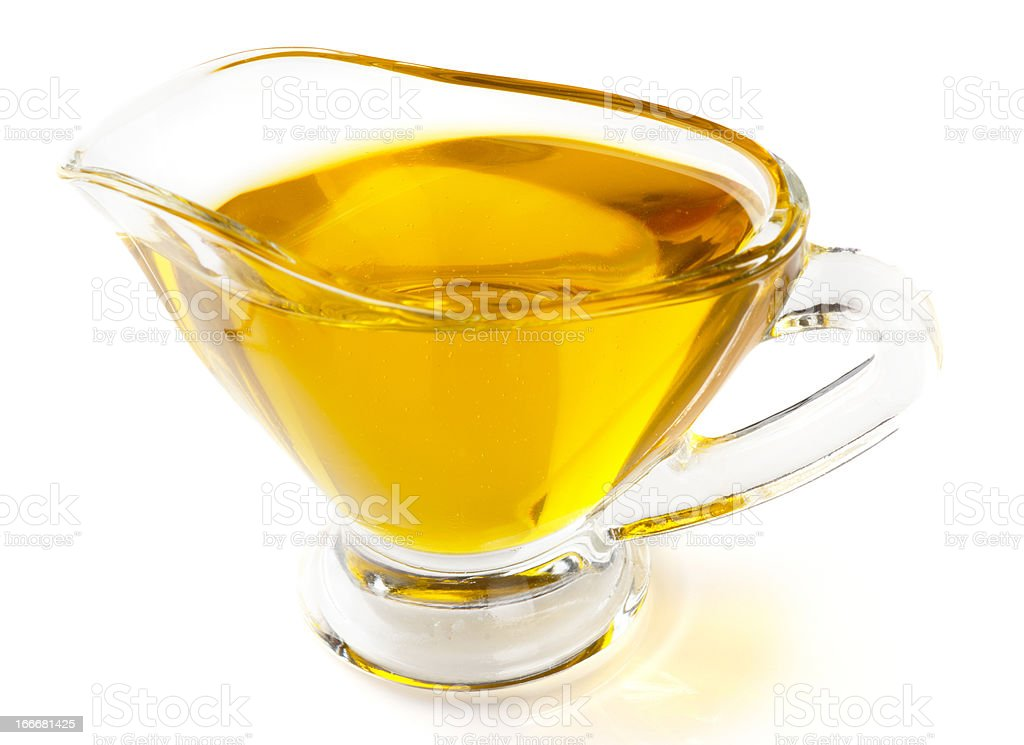 Olive oil in gravy boat, isolated on white royalty-free stock photo