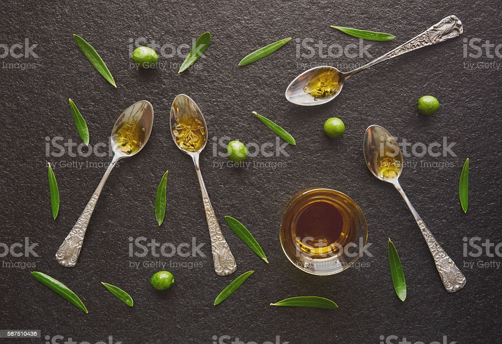 Olive oil in vintage spoons stock photo