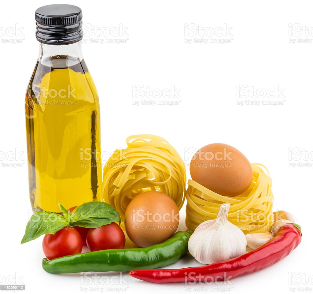 Olive oil, Italian noodles, tomatoes, garlic and basil on white stock photo