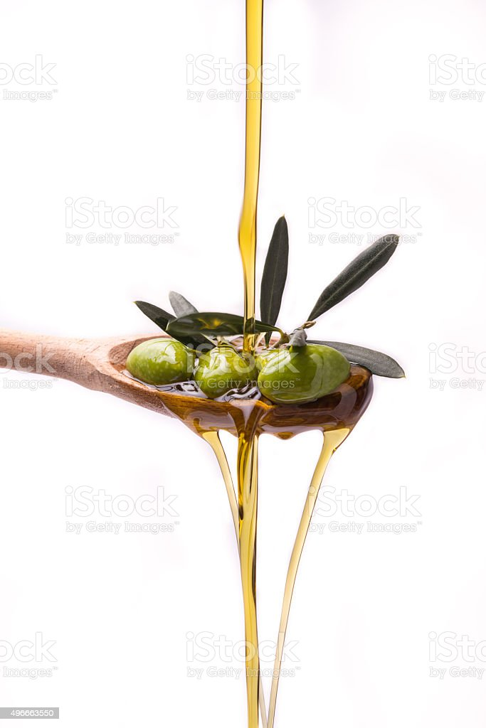 Olive oil on white background stock photo