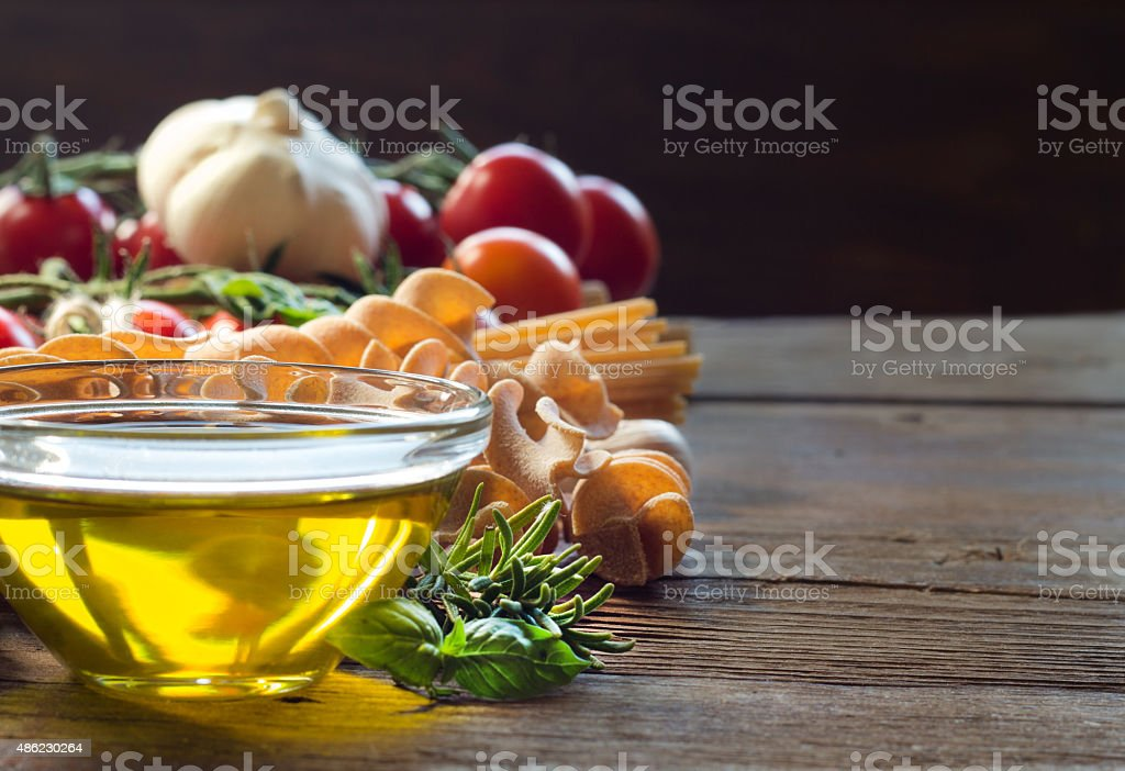 Olive oil, pasta, garlic and tomatoes stock photo