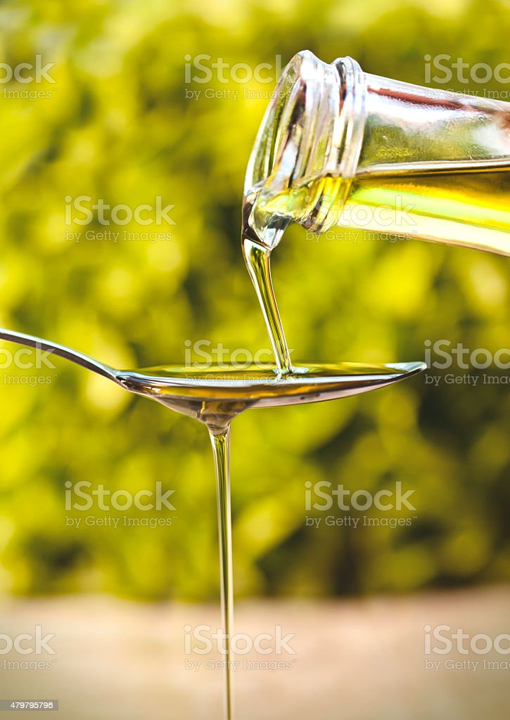 Olive Oil poured onto a spoon stock photo