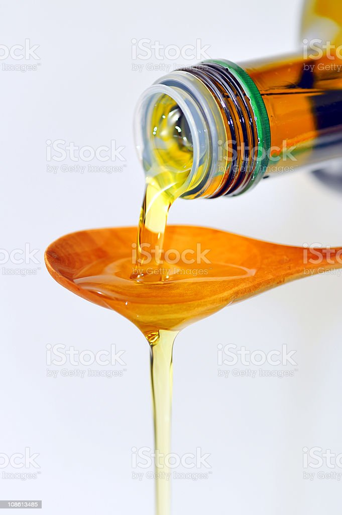 Olive Oil pouring from a bottle royalty-free stock photo