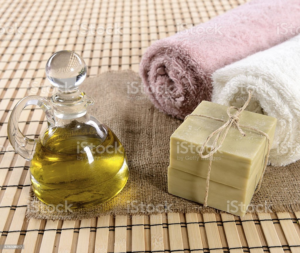 Olive oil soap and bath towel stock photo