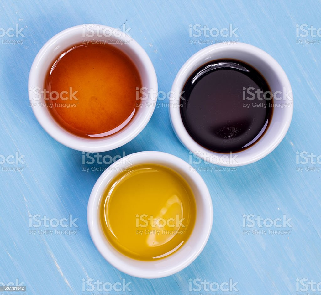 olive oil, soy sauce, sesame oil standing on a wooden stock photo