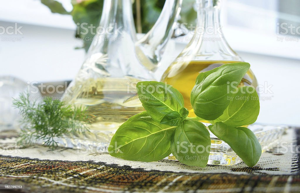 Olive oil, vinegar and basil royalty-free stock photo