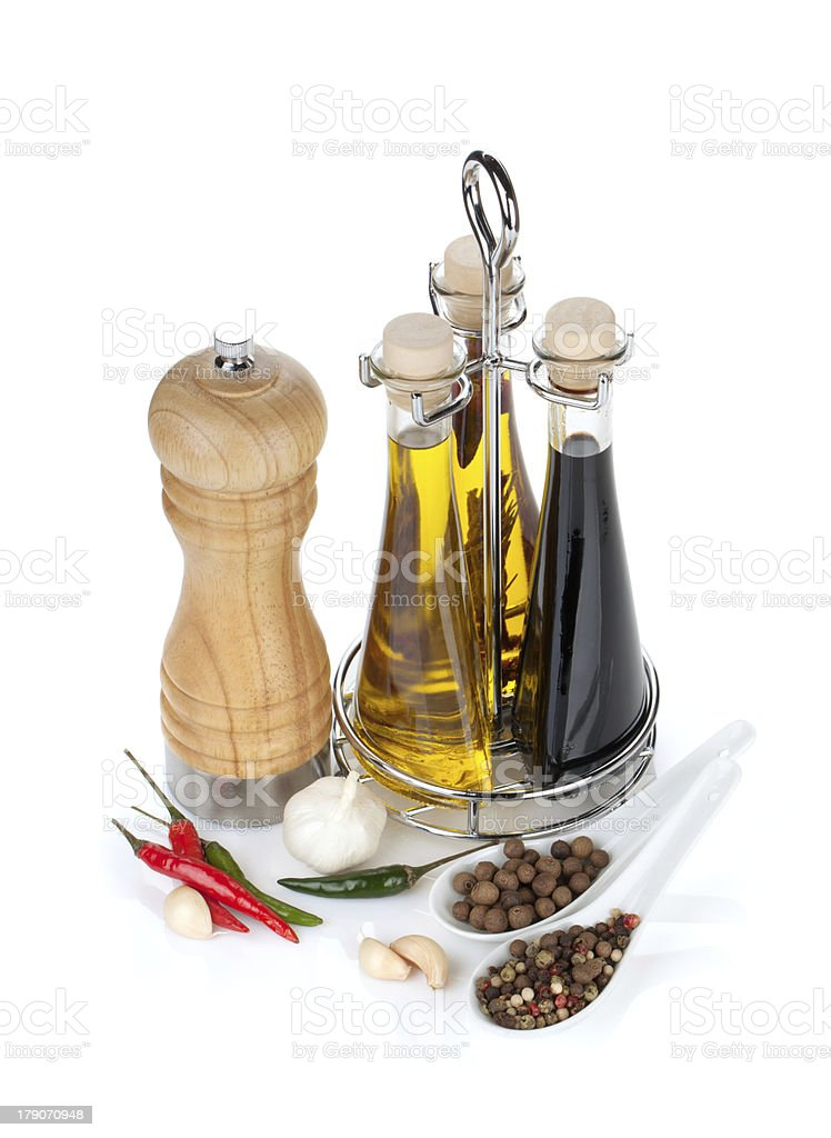 Olive oil, vinegar bottles, pepper shaker and spices royalty-free stock photo