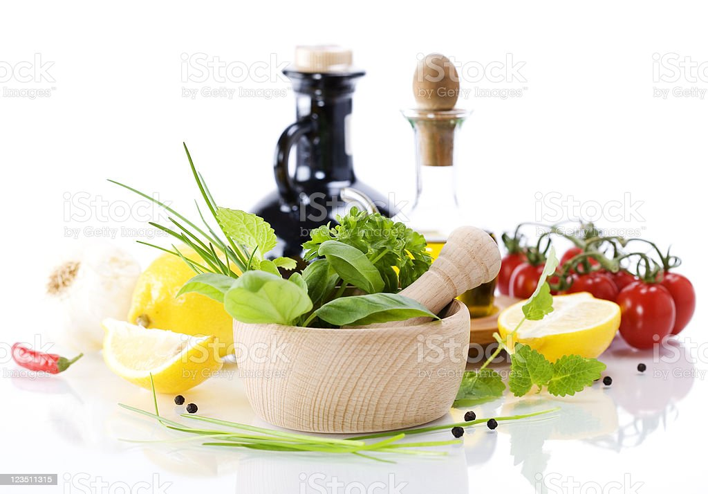 Olive oil, vinegar, Healing herbs and vegetables royalty-free stock photo
