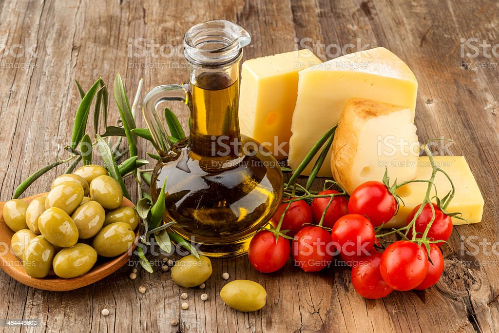 Olive oil with cherry tommatoes and cheese stock photo