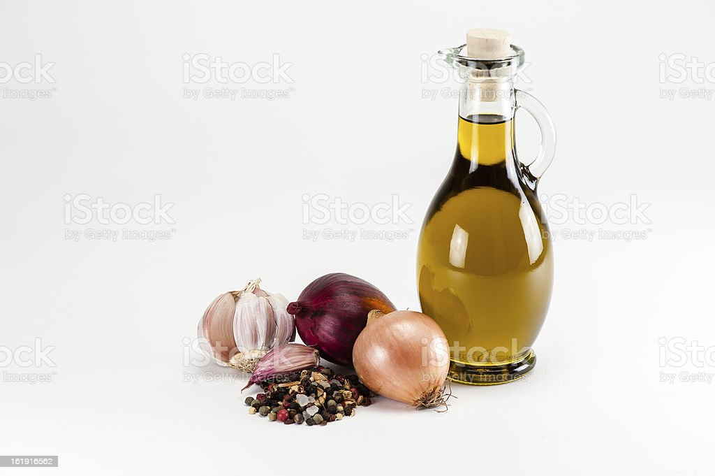 Olive oil with cooking ingredients stock photo