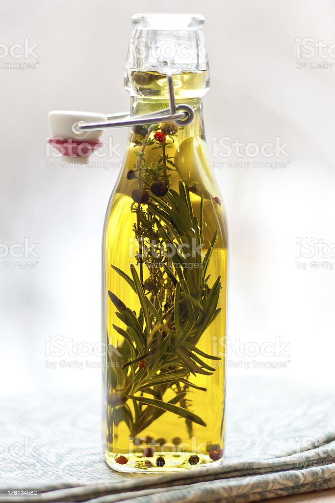 Olive oil with herbs stock photo