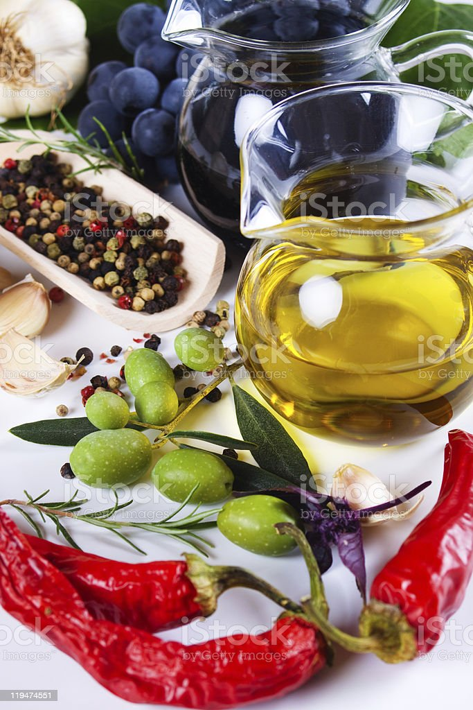Olive oil with spices and food ingredients royalty-free stock photo