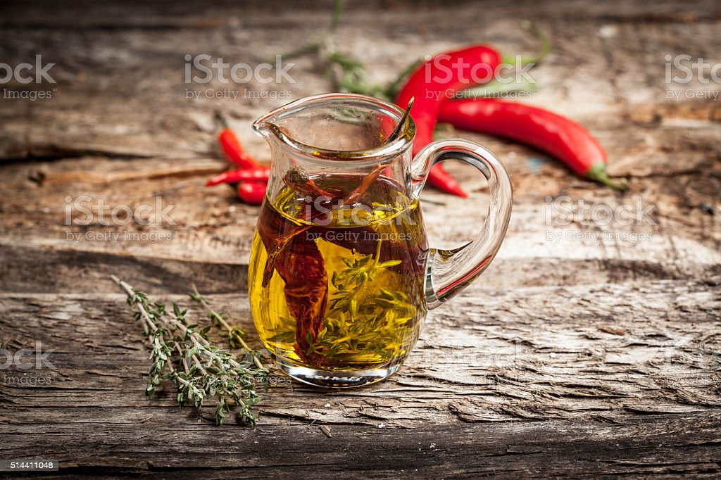 Olive oil with spices and herbs stock photo